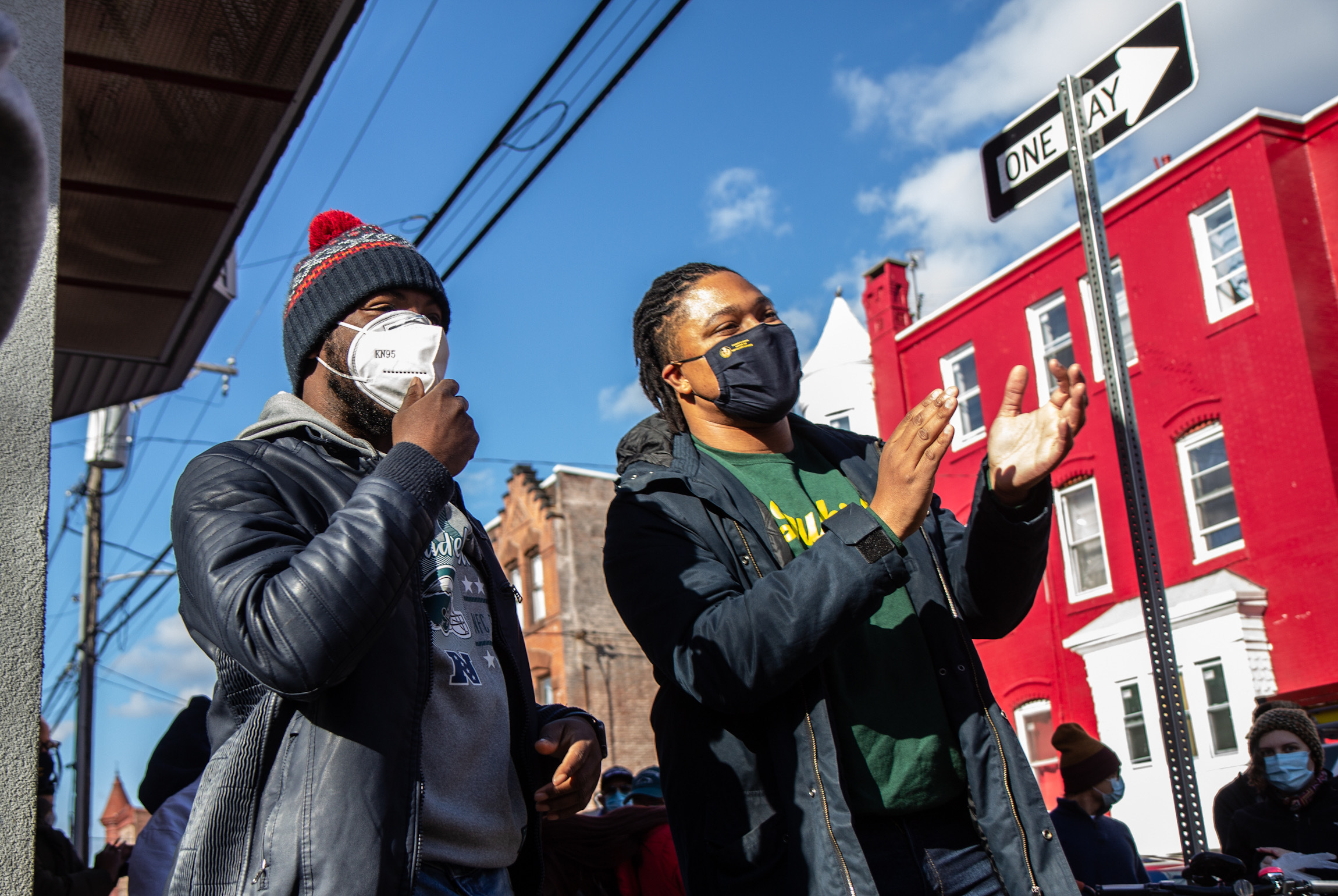 Terrill Haigler and State Rep. Malcolm Kenyatta, wearing face masks, stand on North 17th Street