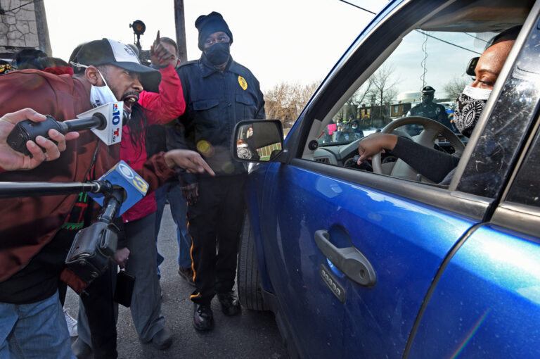 At a Feb. 10 protest of school closures outside Wiggins Elementary School in Camden, public school advocate Gary Frazier confronts Camden School Superintendent Katrina McCombs as McCombs tries to leave after touring the school. (April Saul/WHYY)