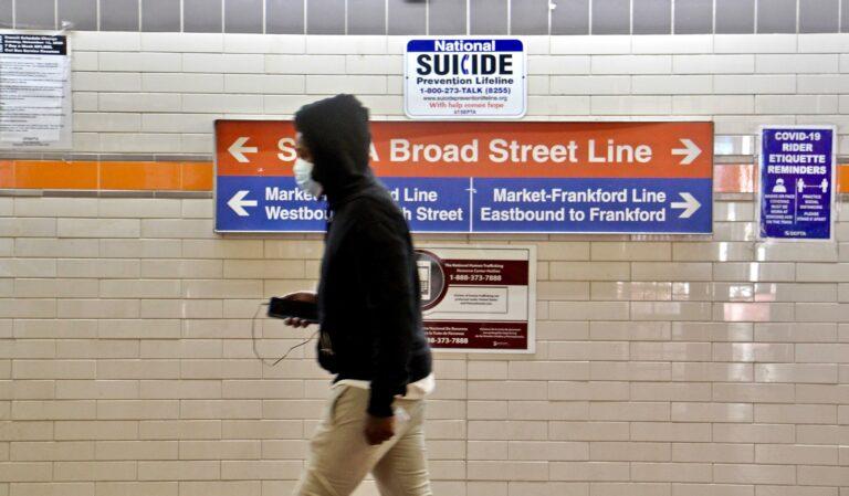 A SEPTA passnger walks toward the subway entrance. (Emma Lee/WHYY)