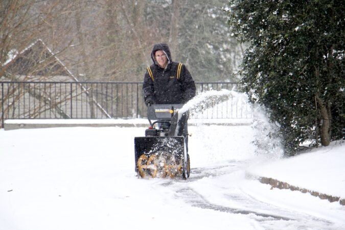 A Moorestoown, N.J., resident clears the snow from his driveway