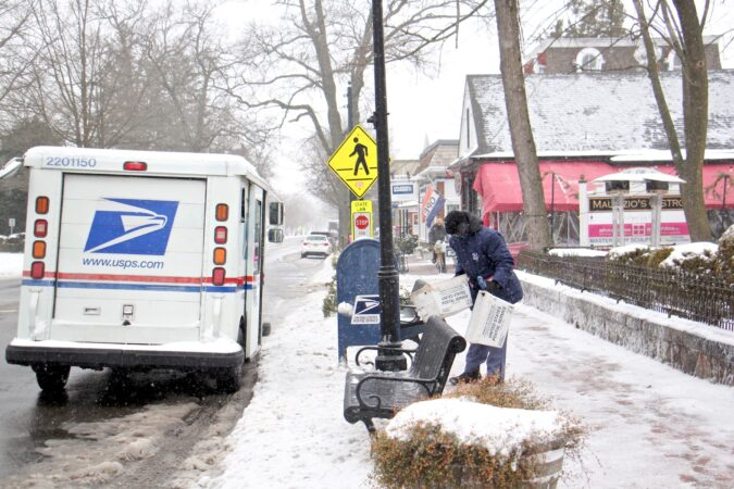 A postal worker delivers the mail in Moorestown