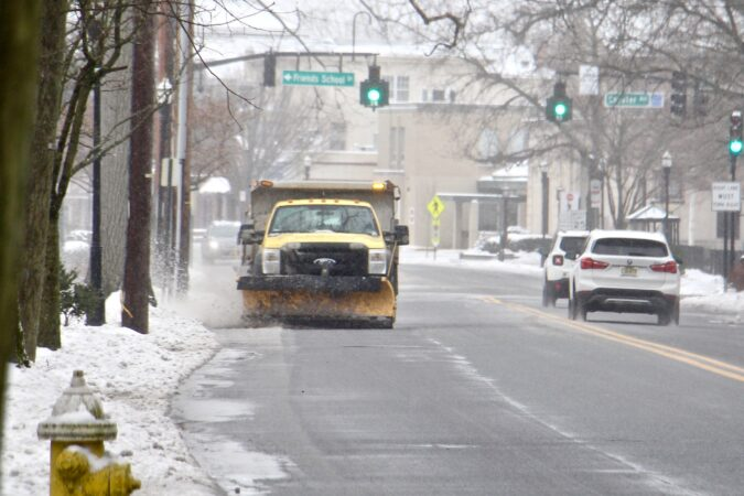 A plow clears the slushy snow from Route 537 in Moorestown, N.J.