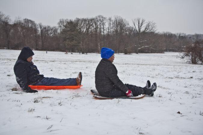 Lynn Nicholas and her husband Dennis Lee sled at Belmont Plateau