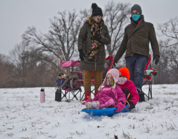 Natasha Mell-Taylor, Jared Greenwald, their child Juniper, and friend Phoebe sled at Fairmount Park