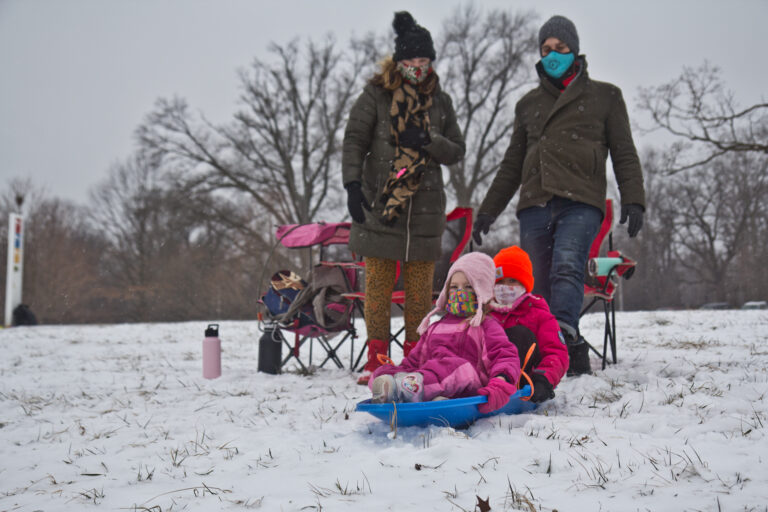 Natasha Mell-Taylor, Jared Greenwald, their child Juniper, and friend Phoebe sled at Fairmount Park