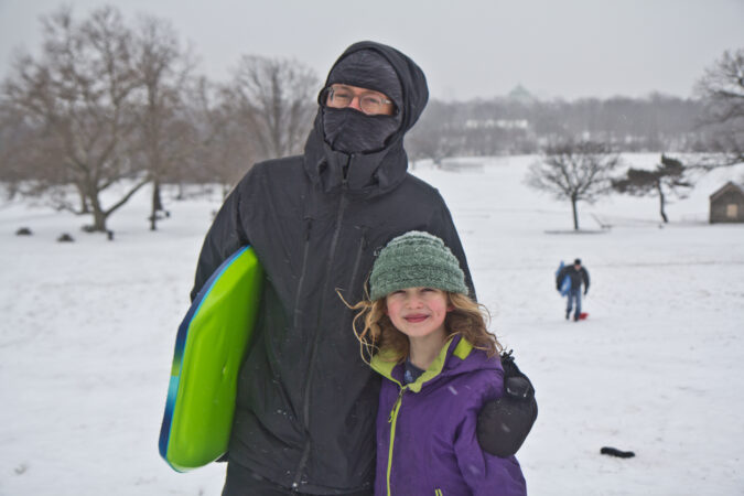 David Zarin and his daughter Phoebe sled in Fairmount Park