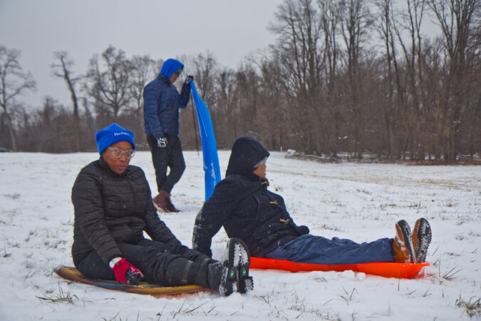 Lynn Nicholas, her husband Dennis Lee, and their son Devin sled in Fairmount Park
