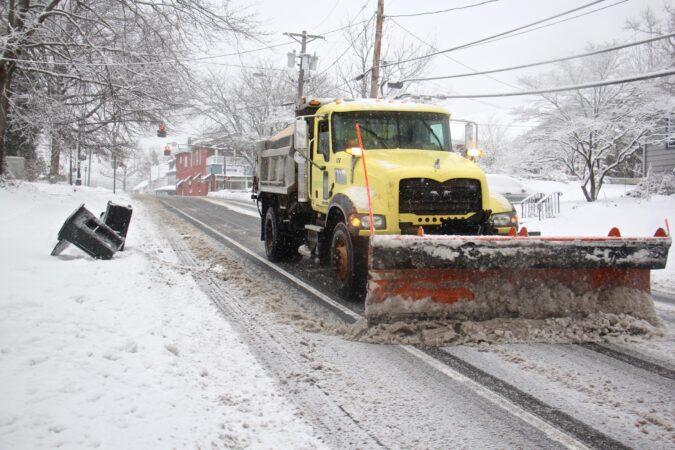 A plow clears Church Street in Moorestown