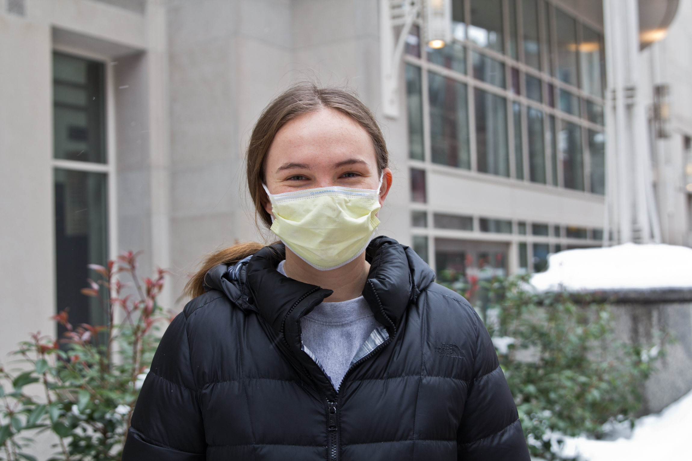 Ellie Cline, wearing a face mask, stands outside the vaccine clinic