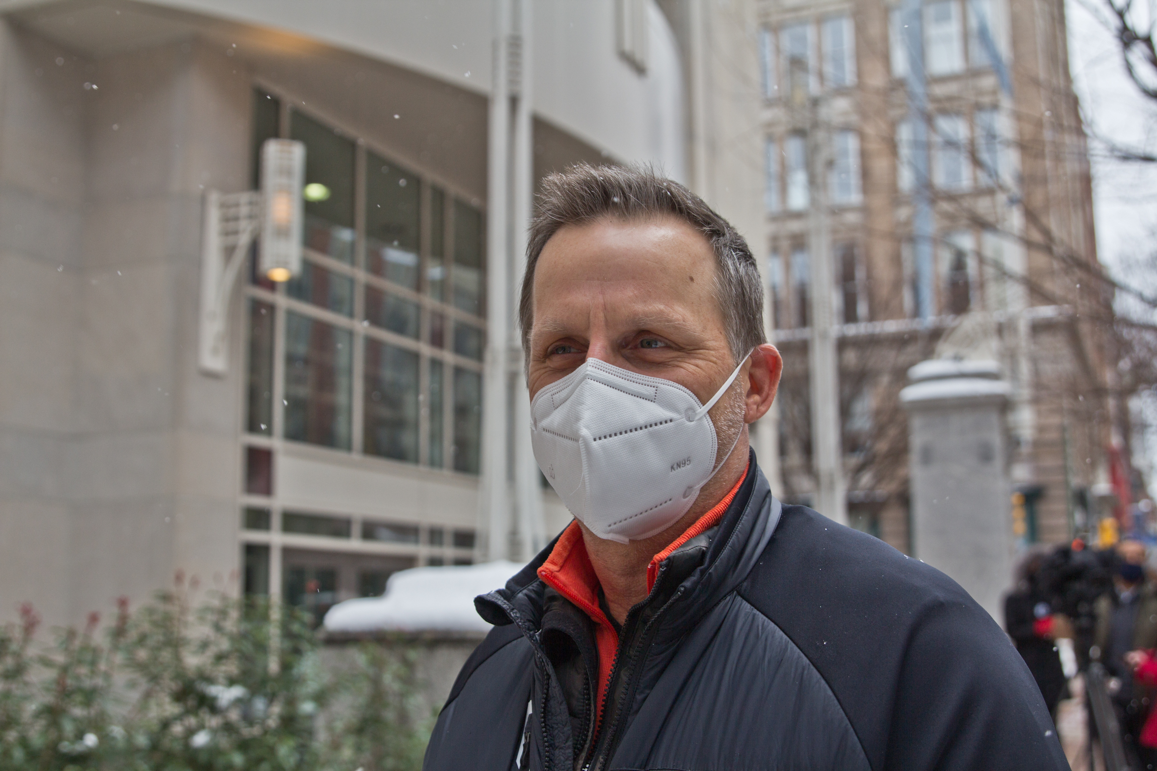 Ted Jelesiewicz, wearing a face mask, stands outside the vaccine clinic
