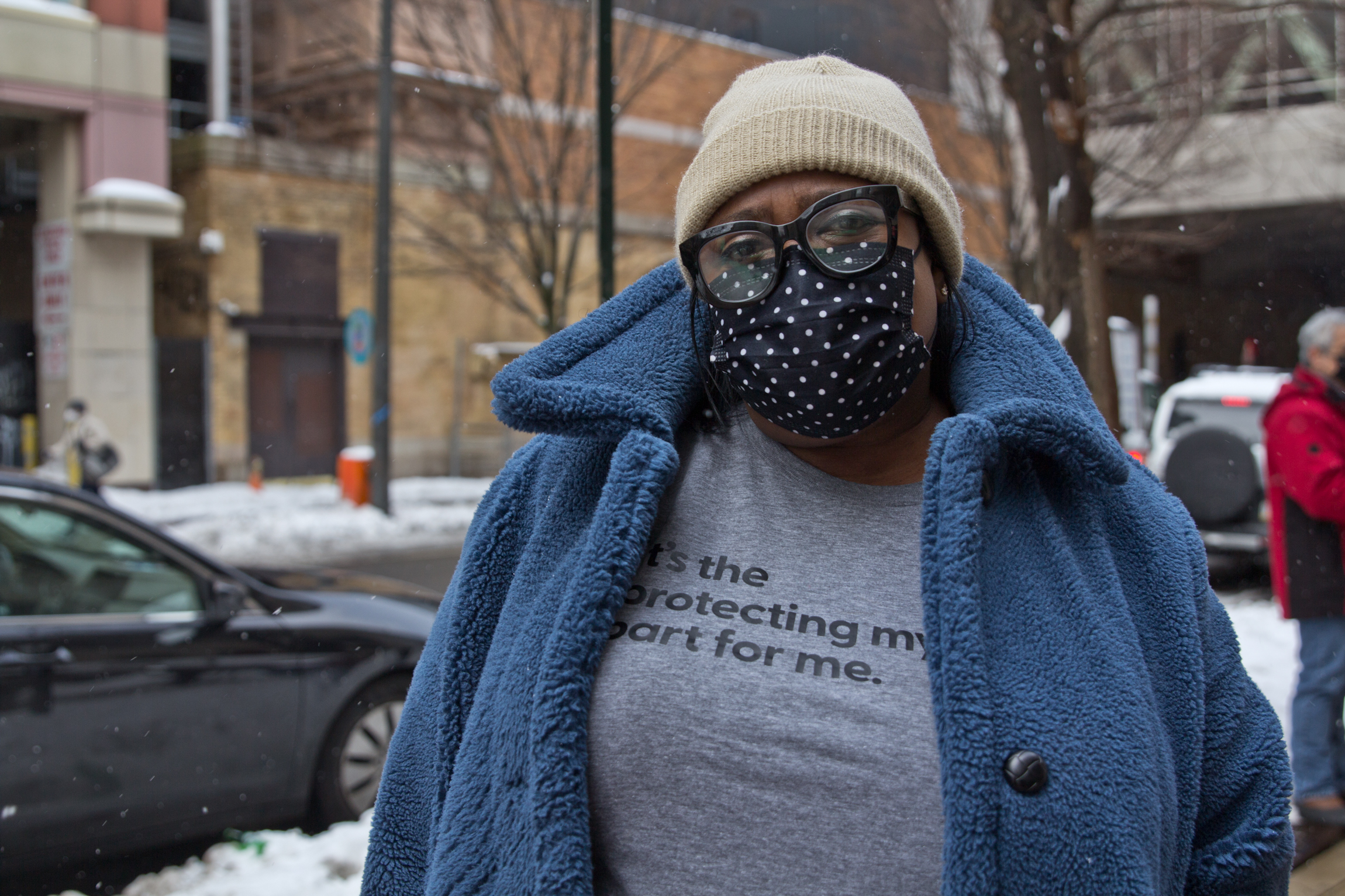Lisa Myers, wearing a face mask, stands outside Philly's COVID vaccine clinic