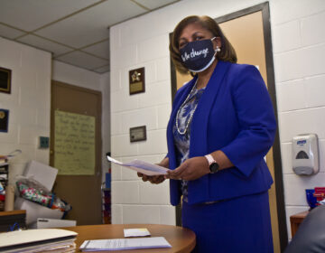 Principal Andrea Surratt at work in her office at E. W. Rhodes Elementary School in Philadelphia. (Kimberly Paynter/WHYY)