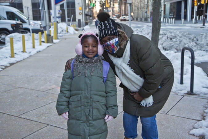Sharon Stewart walks her 6-year-old granddaughter Sana to Russell Byers Charter School in Center City