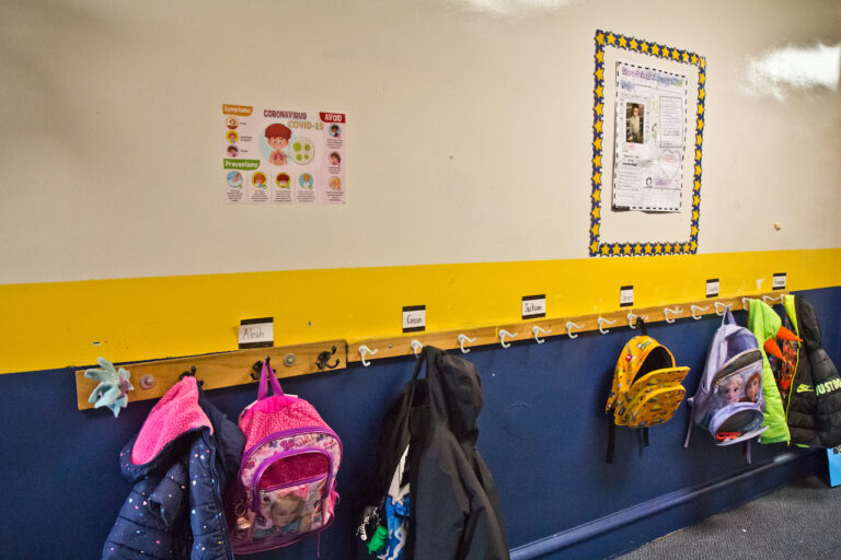 Spaced out coats and book bags at St. Pio Regional Catholic School