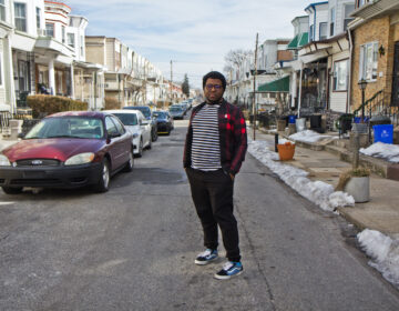 Kyle Hiller outside his home in West Philadelphia. (Kimberly Paynter/WHYY)