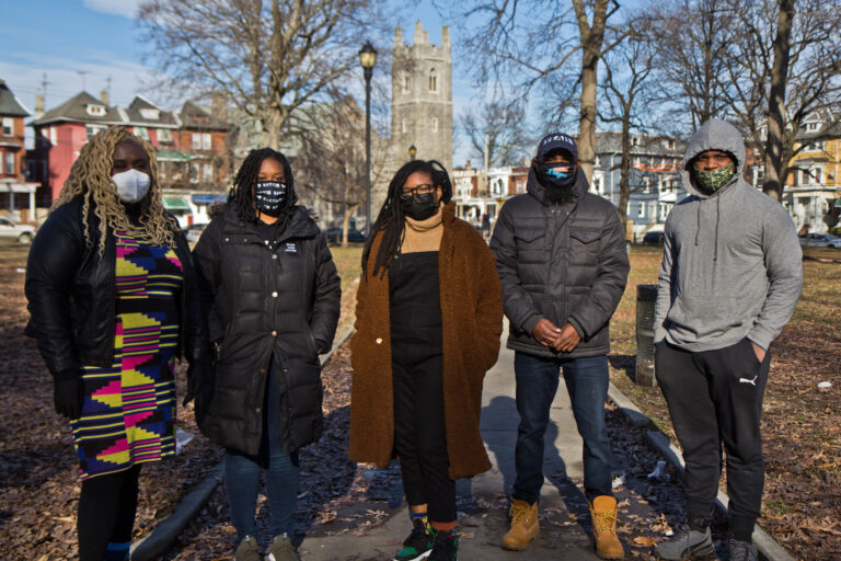 (From left) Nikki Grant, with the Amistad Law Project, Kendra Van de Water with YEAH Philly, Clarise McCants with the Movement Alliance Project, and James Aye and Kameron Troy with YEAH Philly, at Malcolm X Park in West Philadelphia. (Kimberly Paynter/WHYY)