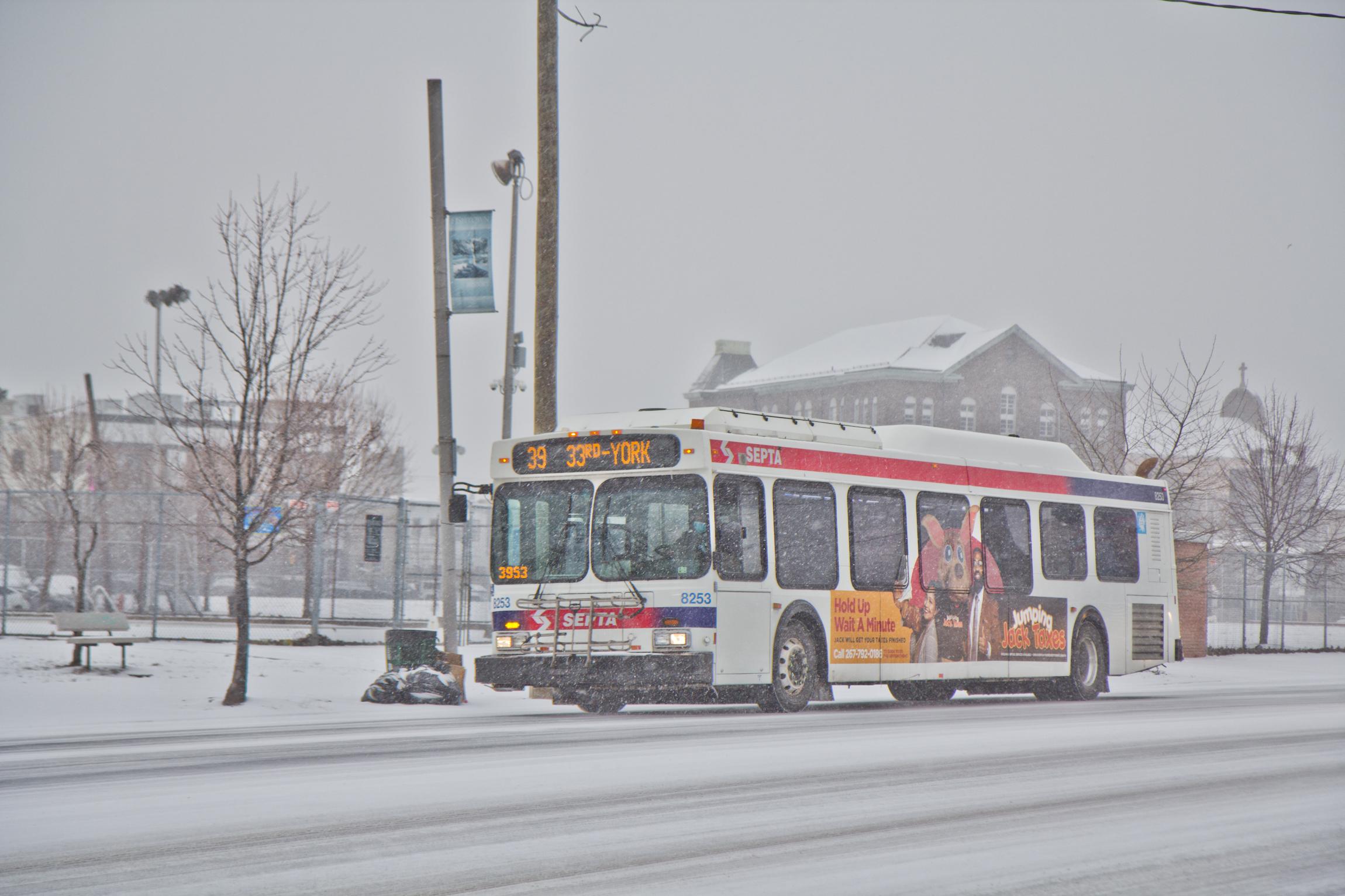 A SEPTA bus glides down Aramingo Avenue in the snow