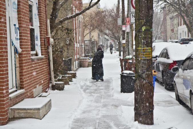 People in Fishtown shovel outside their homes