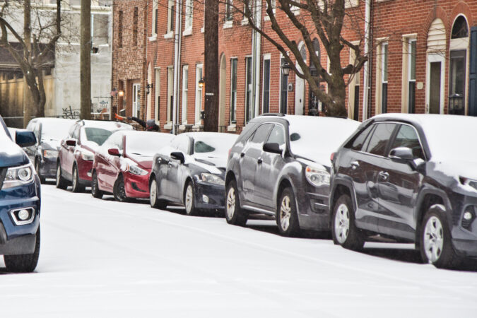 Cars parked on Philly street in the snow