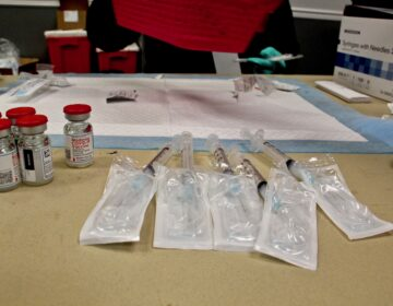 Doses of Moderna's COVID-19 vaccine are prepared at the Liacouras Center, where the Black Doctors Consortium held a 24-hour mass vaccination clinic on Feb. 19, 2021. (Emma Lee/WHYY)