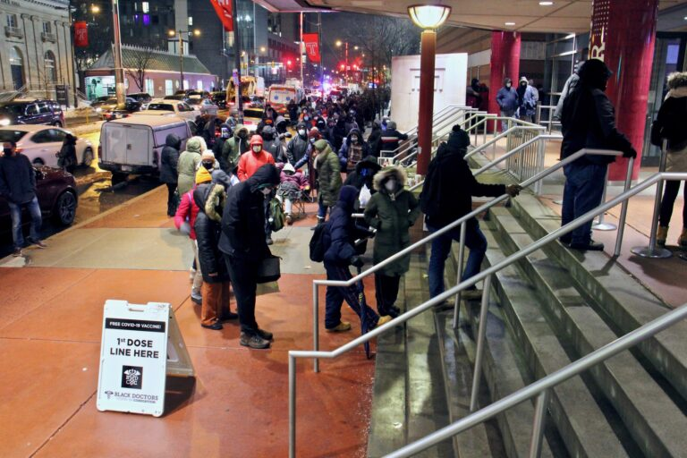 Philadelphians wait in line outside the Liacouras Center at Temple University, where the Black Doctors COVID-19 Consortium was holding a 24-hour vaccination clinic. (Emma Lee/WHYY)