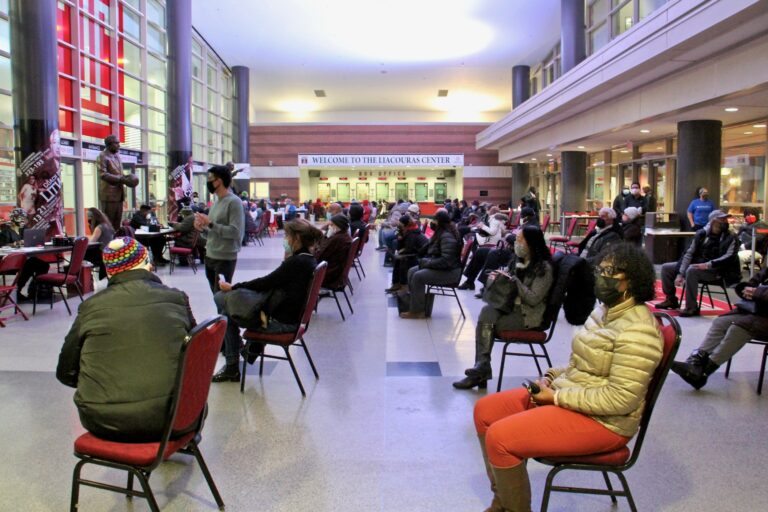 Philadelphians wait in the lobby of the Liacouras Center at Temple University to recieve the Moderna COVID-19 vaccine. The 24-hour vaccination event was organized by the Black Doctors COVID-19 Consortium. (Emma Lee/WHYY)