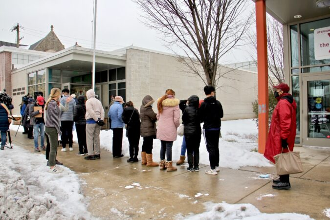 People wait in line for COVID-19 vaccines