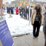 People with appointments wait in line at Philadelphia's first standing city-run COVID-19 vaccination clinic, which opened at the Martin Luther King Jr. Older Adult Center on Cecil B. Moore Avenue, Tuesday, Feb. 23, 2021. (Emma Lee/WHYY)