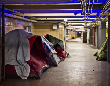 Tents and sleeping bags line the tunnels of the Locust Street Patco Station in Center City on Feb. 23, 2021. (Kimberly Paynter/WHYY)