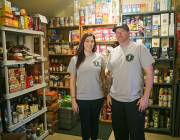 Kelli Aceto and Steve Radie from Audubon Peer to Peer Aid  pose at the group's pantry in Audubon, N.J. on Thursday, Feb. 25, 2021. (Miguel Martinez for WHYY)