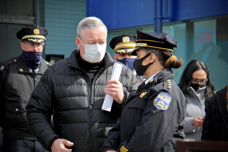 Philadelphia Mayor Jim Kenney and Police Commissioner Danielle Outlaw confer during a press event at Olney Transportation Center, where a mass shooting occurred on Feb. 17, 2021. (Emma Lee/WHYY)