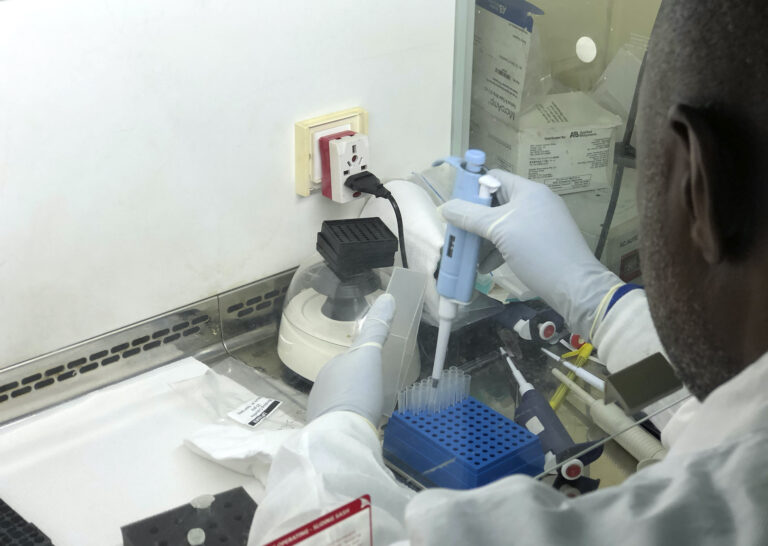 In this photo taken on Friday Dec. 25, 2020, Virologist Sunday Omilabu in a lab, during an interview with The Associated Press in Lagos, Nigeria. (AP Photo/Lekan Oyekanmi)