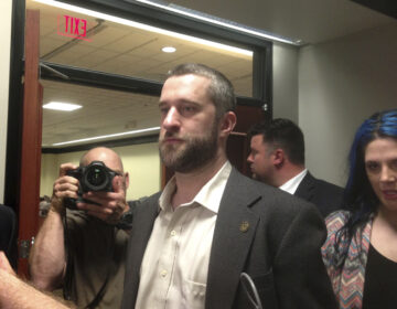 FILE - In this May 29, 2015, file photo, television actor Dustin Diamond, center, leaves court in Port Washington, Wis. (AP Photo/Dana Ferguson, File)
