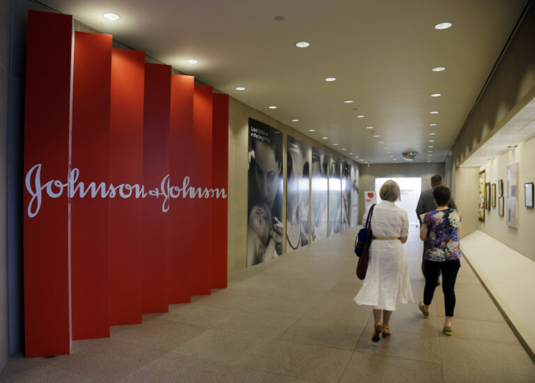 In this July 30, 2013, file photo, people walk along a corridor at the headquarters of Johnson & Johnson in New Brunswick, N.J. (AP Photo/Mel Evans)