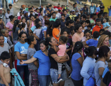 In this Aug. 30, 2019, file photo, migrants, many of whom were returned to Mexico under the Trump administration's
