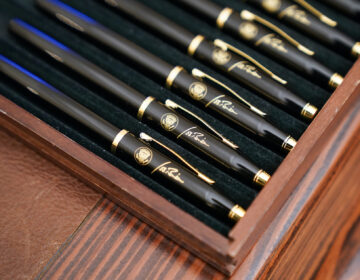 Pens featuring President Joe Biden's signature and presidential seal, are displayed  in the State Dinning Room of the White House, Thursday, Jan. 21, 2021, in Washington. (AP Photo/Alex Brandon)