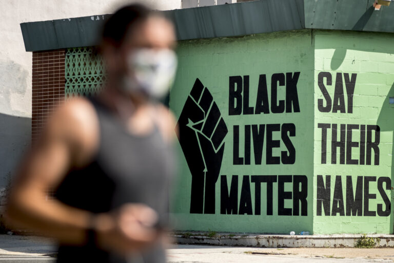 A black lives matter mural is visible in the Shaw neighborhood in Washington, Monday, July 13, 2020. (AP Photo/Andrew Harnik)