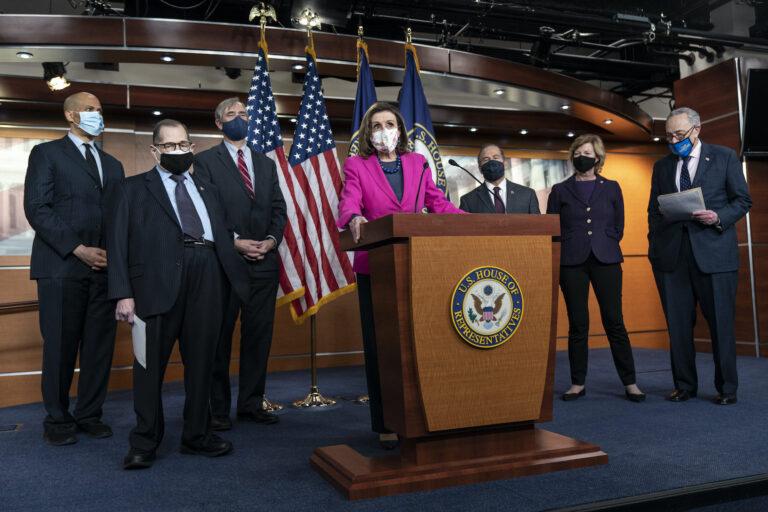 House Speaker Nancy Pelosi of Calif., center, speaks about the Congress Equality Act, Thursday, Feb. 25, 2021, with from left, Sen. Cory Booker, D-N.J., Sen. Jerry Nadler, D-N.Y., Sen. Jeff Merkley, D-Ore., Pelosi, Rep. David Cicilline, D-R.I., Sen. Tammy Baldwin, D-Wis., and Senate Majority Leader Chuck Schumer, D-N.Y., on Capitol Hill in Washington. (AP Photo/Jacquelyn Martin)