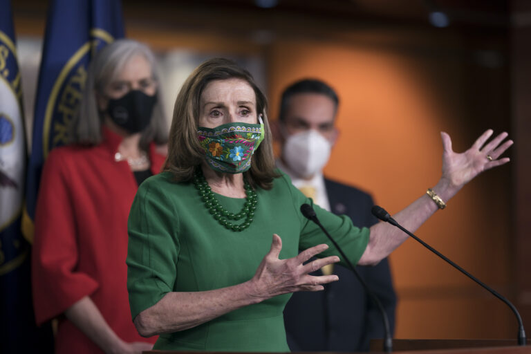 Speaker of the House Nancy Pelosi, D-Calif., meets with reporters before the House votes to pass a $1.9 trillion pandemic relief package, during a news conference at the Capitol in Washington, Friday, Feb. 26, 2021. (AP Photo/J. Scott Applewhite)
