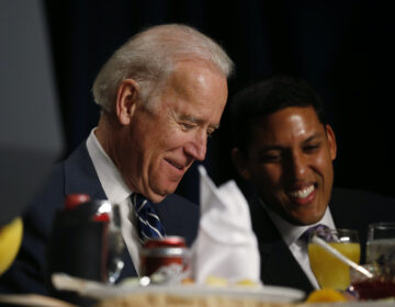 Then-Vice President Joe Biden and USAID administrator Raj Shah are seated together at the National Prayer Breakfast in Washington, Thursday, Feb. 6, 2014. (AP Photo/Charles Dharapak)