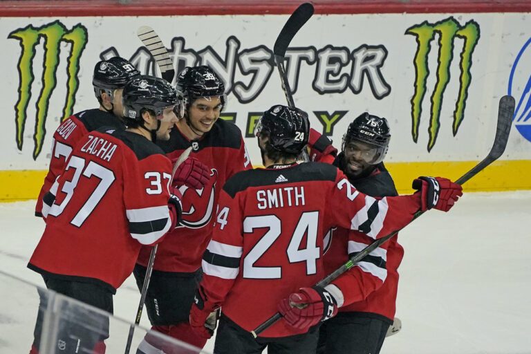 New Jersey Devils celebrate with center Pavel Zacha (37) after he scored a goal