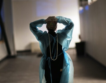 Registered nurse Patricia Carrete walks down the hallways during a night shift at a field hospital set up to handle a surge of COVID-19 patients