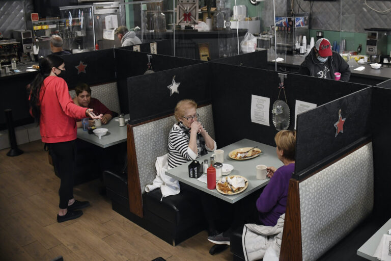 A server talks with a customer seated at Rodd's Restaurant