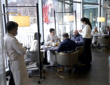 Patrons have lunch indoors at Gibsons Italia restaurant