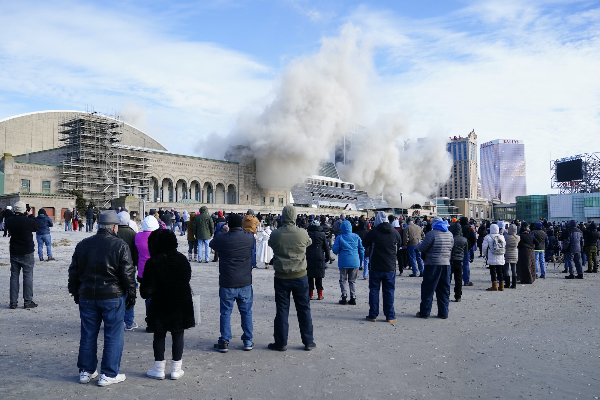 The former Trump Plaza casino is imploded as crowds look on