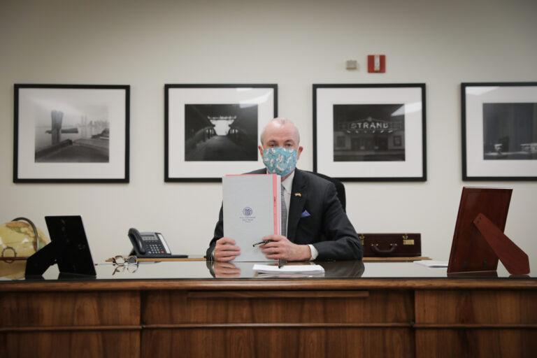 N.J. Gov. Murphy holds up a recreational marijuana bill