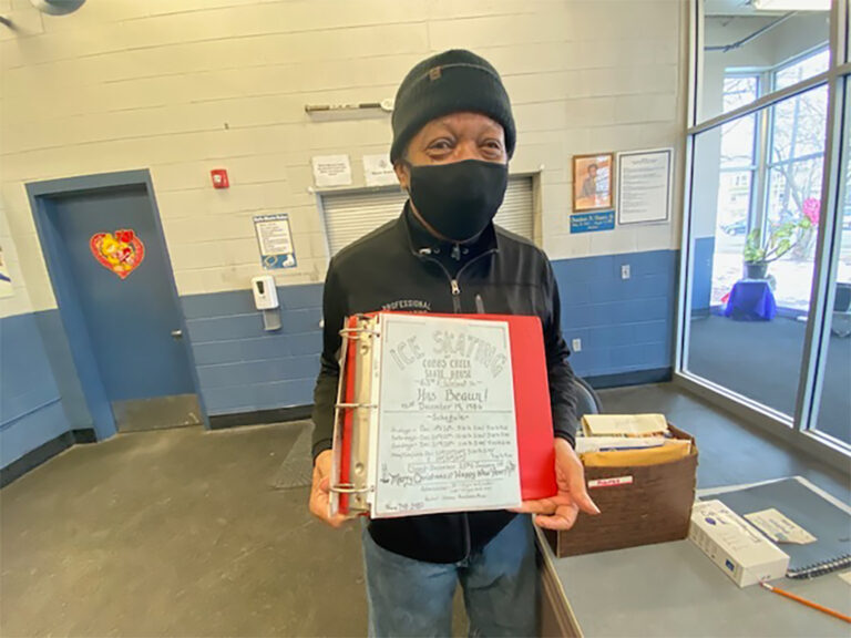 Jimi Lewis, the senior skating instructor at Laura Sims Skate House, holds a flyer from 1986 that he created. (Taylor Allen/WHYY)