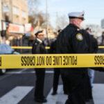 Police tape marks off a crime scene near Olney Transportation Center