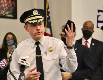 Philadelphia police Inspector Ben Naish talks about the difficulty of identifying the suspects involved in the mass shooting at Olney Transportation Center during an update for reporters at Mathematics, Civics, & Sciences Charter School of Philadelphia, 447 North Broad Street. (Emma Lee/WHYY)