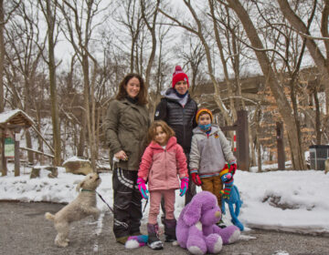 Rachael and Phil Reilly with their children Winnie, 6, and Caden, 8, and dog Rosie, before taking a walk along the Wissahickon Creek in Philadelphia, Pa. (Kimberly Paynter/WHYY)